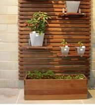 outdoor slat wall + planter boxes or shelves. Fence Planters, Planter Boxes, Privacy Planter, Outdoor Wall Planters, Vertical Planter, Concrete Planters, Pergola Planter, Patio Fence, Planter Garden