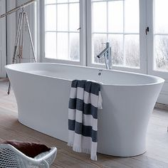 Duravit Cape Cod freestanding bath.  This one has a built in head rest.