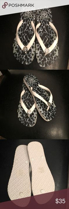 Tory Burch, 8, multi-color animal print sandals NWOT, Tory Burch, size 8, black, white and grey thong sandals.  The flip flop thongs are white with silver Tory Burch emblem buttons attached to the top of them and the footbed part of the sandal is a multi-color cheetah type print with a mixture of black, dark grey, light grey and white in the design.  They also have Tory Burch printed on the heel of each sandal just below the TB logo.  Brand new, never worn as shown in photo of the bottom of…