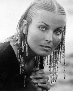 Bo Derek from the movie 10 unfortunately after the movie debuted, she received sole credit for the braided hair style of corn rolls that Black women hair been wearing since the beginning of time. Famous Hairstyles, Black Women Hairstyles, Braided Hairstyles, Braided Mohawk, Bo Derek 10, Bo Derek Braids, Hair Icon, 80s Hair, Heather Locklear