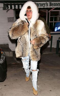 Justin Bieber steps out in a ridiculous fur coat with a huge candy cane and angers animal rights groups - DigitalSpy.com