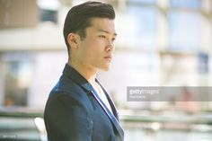 Young man standing and thinking inside his office#http://www.gettyimages.com/galleries/photographers/mamigibbs