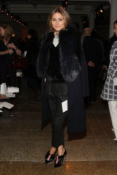 The street style star cozied up in a black fur collar at Peter Som's show.