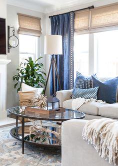 Coastal Family Room Blue And White Pillows Gray Walls Roman Shades Axis