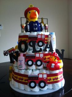 Firetruck Diaper cake this would be PERFECT for my sister n law if I could talk her into having another baby. Baby Shower Diapers, Baby Boy Shower, Baby Shower Gifts, Diaper Crafts, Baby Crafts, Firefighter Baby Showers, Fireman Party, Nappy Cakes, Baby Shower Themes