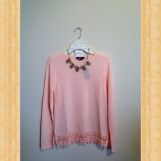Lightweight soft touch sweater. Beautiful lightweight soft touch sweater with lace hemline color: peach (necklace sold separately) Sweaters