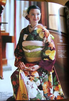 Scans: Contemporary Wedding Kimono | These scans show how the kimono is evolving as formal wear, with traditionally styled kimono being paired with modern hairstyles on almost every page. Motifs and colours are chosen to represent the season as well as having symbolic meaning – for example the crane, which mates for life, represents longevity and fidelity.