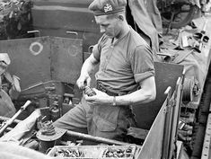 Lance-Corporal George Gagnon, 14th Field Regiment, Royal Canadian Artillery (R.C.A.), aboard a Landing Ship Tank fusing hand grenades to be used on D-Day. Southampton, England, 4 June 1944.