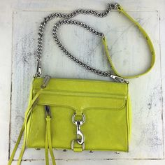 """[Rebecca Minkoff] Mini MAC Convertible Crossbody Classic Rebecca Minkoff cross-body bag. Has a slight texture to it, almost like a snake skin. Adds a pop of color to any outfit.  Color: Chartreuse Green & Silver Fabric: Leather Dimensions: 9""""W x 5.5""""H x 2""""D Strap Drop: 22.5""""  Condition: GUC. Small mark on front left of bag (see 2nd picture). 2 marks on back of bag (see 3rd picture). A little bit of wear in bottom corners of bag (last picture). Lots of life left in this beautiful bag.  No…"""