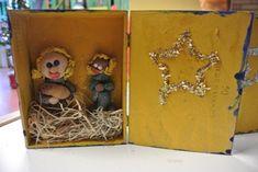 kerststal van een sigarenkistje met brooddeeg kerstfiguren