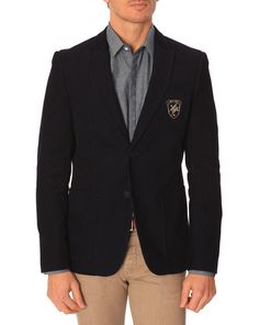 Peak lapel patch pocket crested blazer