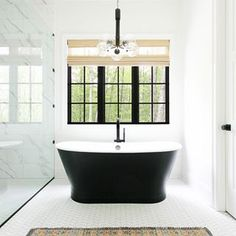 There are several factors to consider when choosing what grout color you should go with. You should consider things like the location, pattern, and undertones. It is also very important to think about what overall look you want or are trying to achieve. Master Bath Tile, Bath Tiles, Beautiful Houses Interior, Beautiful Homes, Cheap Home Decor, Diy Home Decor, Building A Porch, Porch Swing, Porch Bed