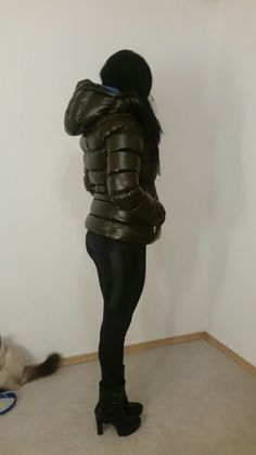 Videos and images of sexy girls wearing puffy and shiny down jackets and coats.