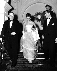 """Mel Ferrer & Audrey Hepburn at one of the """"Roman Holiday"""" premieres (perhaps on January 8, 1954 in the Netherlands)."""