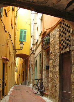 """""""A typical narrow medieval street alley in Menton France"""""""