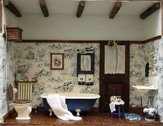 Stunning detail - love the blue roll top bath - mini bathroom. Think it's a chrysnbon bathroom kit.