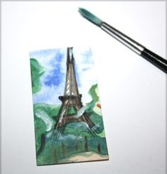 Original Miniature collectible Dolls house Painting portraying a Parisian landscape with the Eiffel tower. Painting Size approximately : 3,5 x 6,5 cm / 1,3 x 2,5 inches Works best in 1 : 12 scale doll house/ miniature box. Free shipping worldwide.