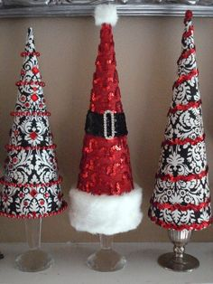 Crafty cone shaped Christmas tree's for the mantle... Black and Red decorating ideas