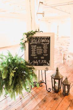 BRIK Venue | Fort Worth | Texas | Wedding | Ceremony | Program | Chalkboard | Lanterns | Greenery | White Roses | Industrial | Warehouse | Wood Floors | White Brick | Wood Benches | Ashley Arrington Photography | Fig Floral