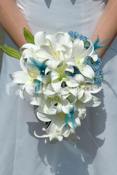 Ivory Easter Lily Bridal Bouquet with Aqua Gerberas and Feathers