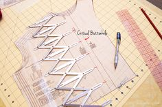 This tool measures button placement perfectly- what a great tool! Image of Simflex Expanding Sewing Gauge