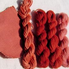 Madder dyed...The samples in the image are all mordanted with alum and dyed in the same dye bath, they are from left to right:- Linen, Silk, Wool, Wool and Wool.