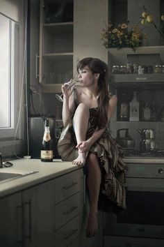 drinking the champagne after death, sitting on kitchen counter