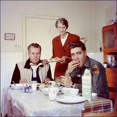 Elvis with his father and grandmother in 1959.