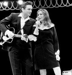 Johnny Cash and June Carter photographed on stage by Baron Wolman, 1967.