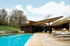 Architect Michael Goorevich renovated this private residence and updated its midcentury modern style.