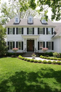 CURB APPEAL – another great example of beautiful design. White Colonial House with traditional exterior in chicago by Normandy Remodeling.