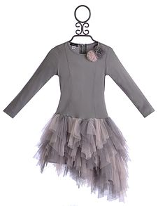 $74.00 this new arrival is from Kate Mack. The grey bodice offers her a drop waist and long sleeves. A hidden zipper runs up the back while two pin tucks offer a more structured shape for the front. The flower duet found on the neckline is made from sweet tulle and a sparkling center. The matching skirt is layered in grey and pink tulle ruffles. The asymmetrical hemline is a unique finish! Cotton/Polyester/Spandex. Place inside mesh laundry bag and machine wash cold. Hang to dry.