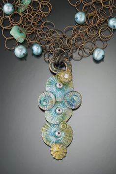Julie Shaw, artisan, has been designing and making exquisite jewelry for over 30 years for galleries and other fine stores. Her handcrafted artisan jewelry creations are worn by both the typical individual and the famous. Julie's jewelry is true art. wearable art and goes equally well with jeans or formal attire.
