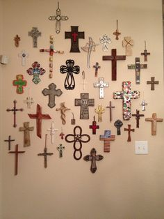 """My Cross Wall.  My Grandson calls this a """"cross collage""""!"""