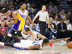 Dec. 1, 2015: 76ers guards Hollis Thompson (31) and T.J. McConnell (12) hit the deck to try and corral a loose ball during the second half against the Lakers in Philadelphia. The hustle paid off as the 76ers prevailed 103-91 for their first win of the season after an 0-18 start.  Bill Streicher, USA TODAY Sports