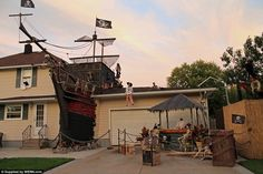 This incredible Halloween yard display featuring a full-sized pirate ghost ship wreck with a house in Lorain, Ohio, certainly makes my timbers shiver...with admiration.