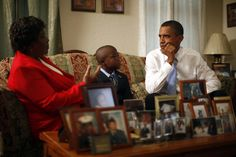 President Obama listens to Maude Smith and her grandson David Robichaux Jr. in their home in the Columbia Parc Development in New Orleans, Louisiana, on August 29, 2010.