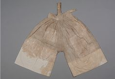 """Unlined, hemp Dansokgot/Unlined Underpants, patched with 24cm wide ramie cuffs. Excavated from the tomb of the Danyang Uo clan, belonging to the wife of Goh. L 91㎝ W 63㎝ Waist 92㎝ Waistband width 9.5㎝ """"A suspender-like strap, 23cm in length, is attached on the waist band, and the adjusting ties"""" partly remain. The side slit is 12cm long. Circa the time of the Imjinwaeran? At the Dankook University Seok Juseon Memorial Museum."""