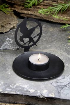 """""""Mockingjay"""" Votive Tea Light Shadow Casting  not that I am a hunger games nerd or anything"""