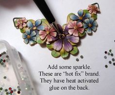 Polymer clay spring bouquet necklace tutorial. checkout the photo strip at bottom of photo.