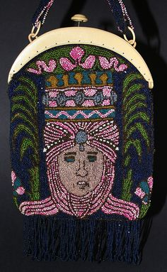 A simple frame tops a beaded bag that has a Bedouin on it. Not the typical Egyptian Revival purse but a unique piece nonetheless.