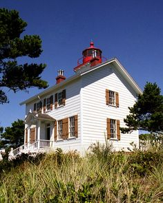 Yaquina Bay Lighthouse in Newport, OR.  Super old school and maybe haunted!  The house is now a museum of how families lived while tending to the lighthouse.  There's a shop in the basement for souvenirs.