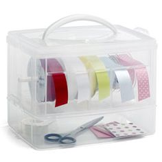 Love this for ribbons year round...The Container Store > Snap 'n Stack™ Ribbon Dispenser