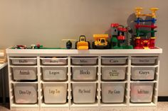 IKEA Trofast storage towers and bins with Lego boards glued on top - fabulous idea!