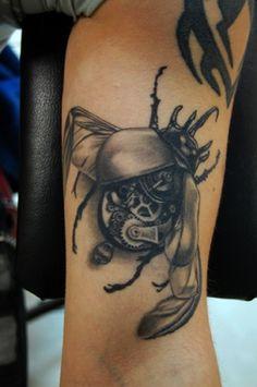 tattoo of a mechanical bug