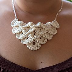 Cotton crocodile necklace on a slender metal chain.
