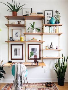 Track shelving might be the most common in a pantry, office or garage, but if you know how to style it right, it can be beautiful enough to sit front and center right in the living room