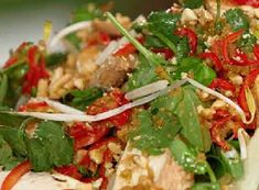 Poached chicken breasts are added to Asian salad vegetables and seasoned with an Asian style dressing to make a tasty side dish or main dish meal