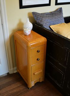 """$120. Vintage two drawer cabinet. It has the rounded corners of the Art Deco style. Glamorous, functional, modern look, striated golden yellow paint finish and the original wooden wheels! It would make a great side table or nightstand. 12"""" wide x 18"""" deep x 31.5"""" tall."""