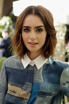 Lilly Collins shoulder length hair with her full bold eyebrows~